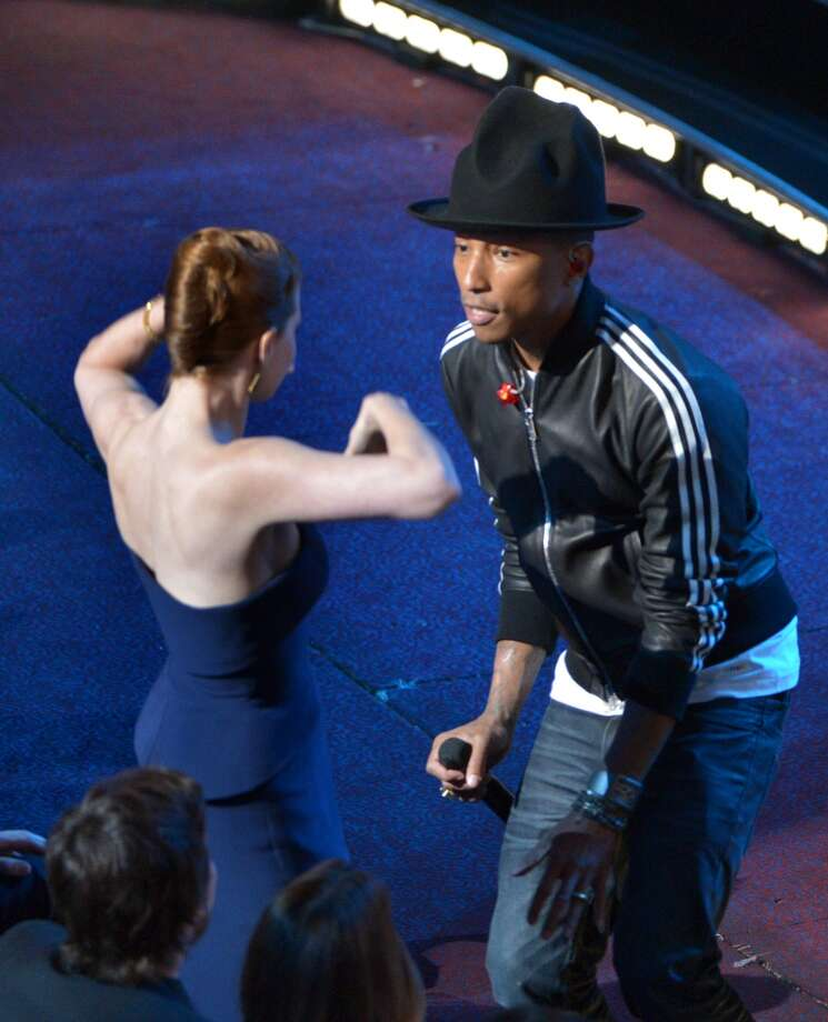 "Amy Adams, left, dances with Pharrell Williams during his performance of ""Happy"" at the Oscars at the Dolby Theatre on Sunday, March 2, 2014, in Los Angeles. Photo: John Shearer, Associated Press"