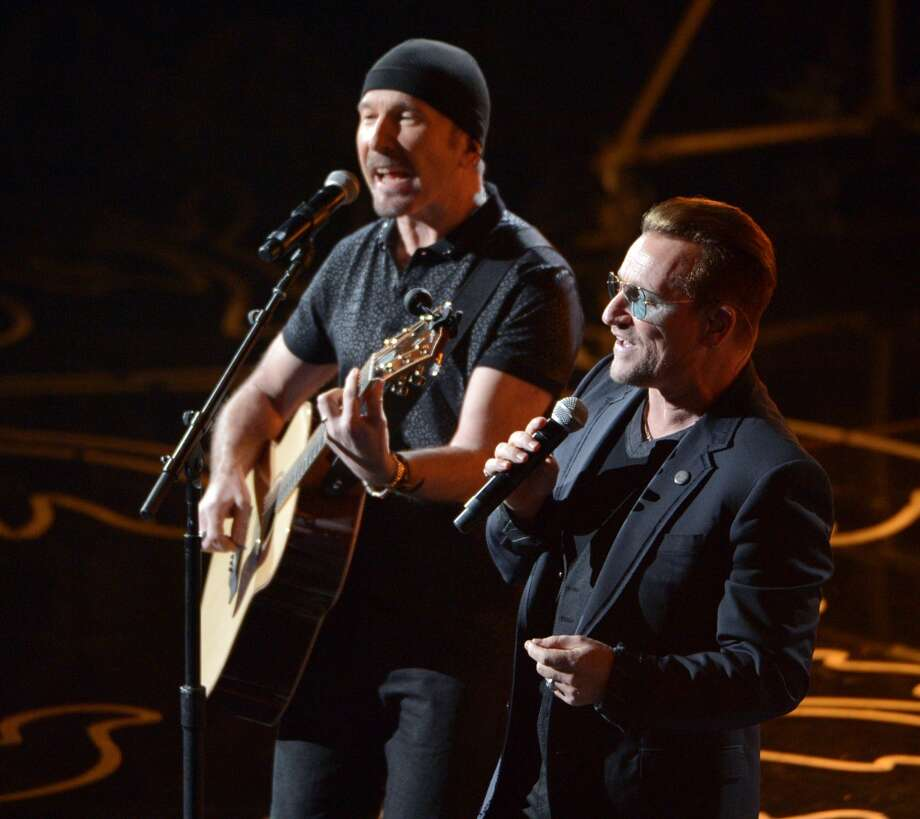 The Edge, left, and Bono of U2 perform on stage during the Oscars at the Dolby Theatre on Sunday, March 2, 2014, in Los Angeles. Photo: John Shearer, Associated Press