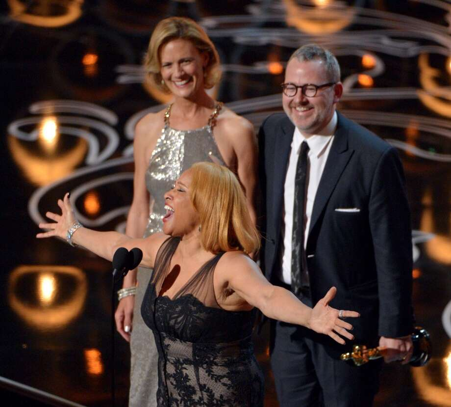 "Darlene Love, center, sings as Janet Friesen, background left, and Morgan Neville accept the award for best documentary feature for ""20 Feet from Stardom"" during the Oscars at the Dolby Theatre on Sunday, March 2, 2014, in Los Angeles. Photo: John Shearer, Associated Press"