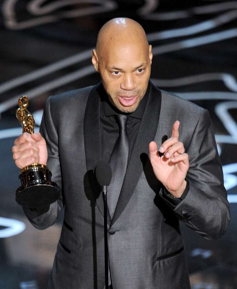 Screenwriter John Ridley accepts the Best Screenplay Based on Material Previously Produced or Published award for '12 Years a Slave' onstage during the Oscars at the Dolby Theatre on March 2, 2014 in Hollywood, California. Photo: Kevin Winter, Getty Images