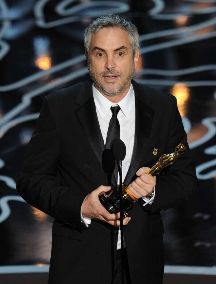 Director Alfonso Cuaron accepts the Best Achievement in Directing award for 'Gravity' onstage during the Oscars at the Dolby Theatre on March 2, 2014 in Hollywood, California. Photo: Kevin Winter, Getty Images