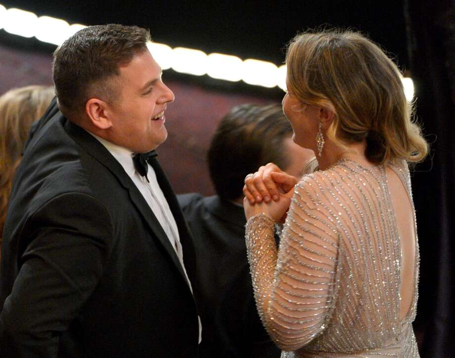 Jonah Hill, left, and Julie Delpy speak in the audience at the Oscars at the Dolby Theatre on Sunday, March 2, 2014, in Los Angeles. Photo: John Shearer, Associated Press
