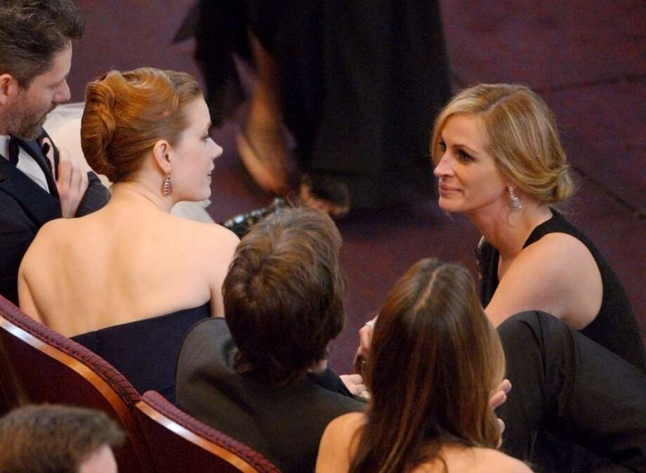 Amy Adams, left, and Julia Roberts are seen in the audience at the Oscars at the Dolby Theatre on Sunday, March 2, 2014, in Los Angeles. Photo: John Shearer, Associated Press