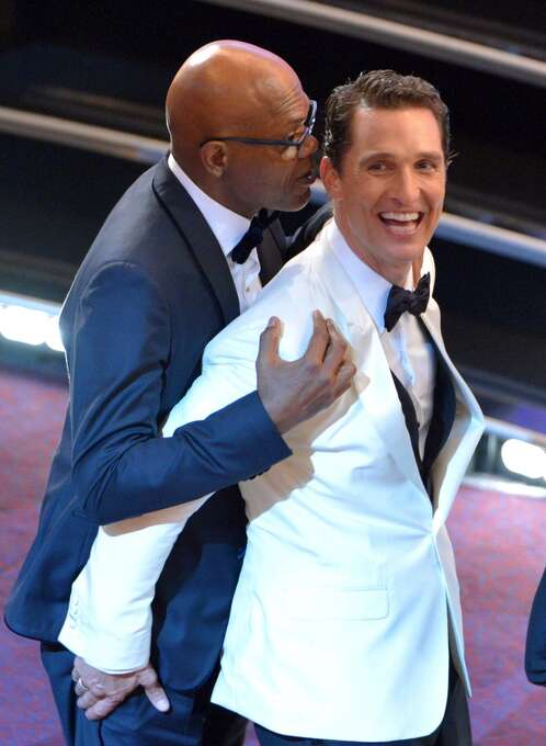 Samuel L. Jackson, left, and Matthew McConaughey embrace in the audience at the Oscars at the Dolby Theatre on Sunday, March 2, 2014, in Los Angeles. Photo: John Shearer, Associated Press