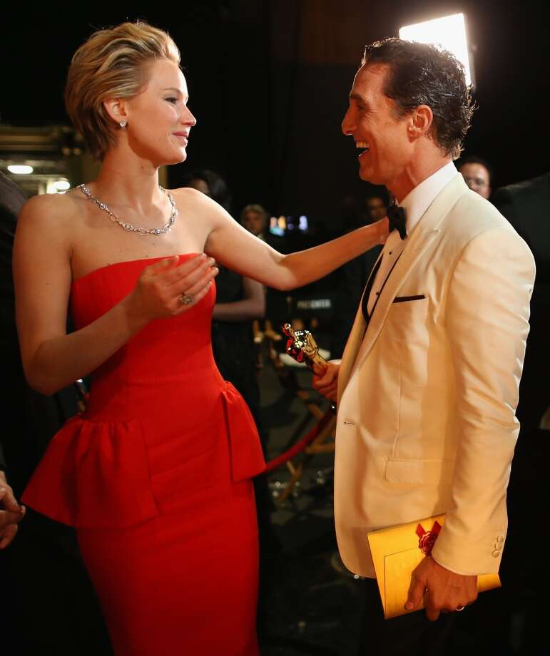 Actress Jennifer Lawrence and Best Actor Award winner Matthew McConaughey speak backstage during the Oscars held at Dolby Theatre on March 2, 2014 in Hollywood, California. Photo: Christopher Polk, Getty Images
