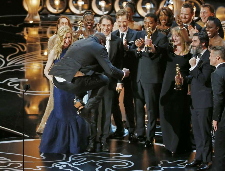 "Director Steve McQueen jumps after accepting the best picture prize for ""12 Years a Slave"" at the 86th annual Academy Awards. Photo: Lucy Nicholson, Reuters"