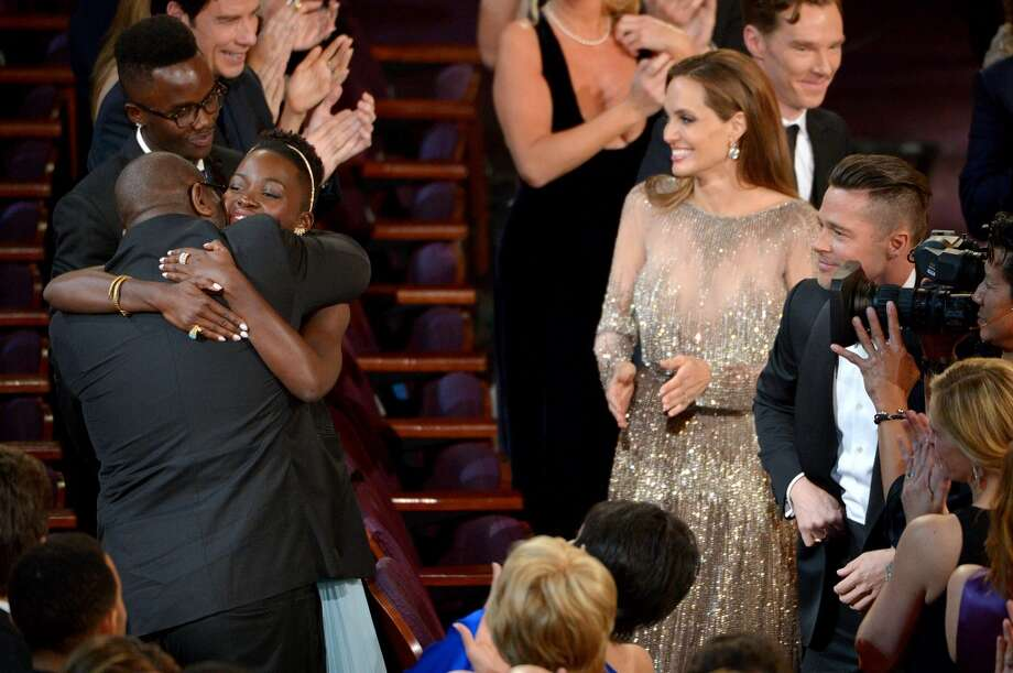 """Steve McQueen, left, and Lupita Nyong'o celebrate in the audience after """"12 Years a Slave"""" is announced as winner of the award for best picture of the year during the Oscars at the Dolby Theatre on Sunday, March 2, 2014, in Los Angeles. Photo: John Shearer, Associated Press"""