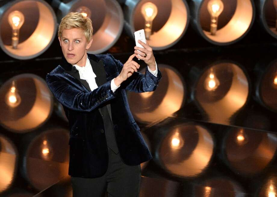Host Ellen DeGeneres speaks onstage during the Oscars at the Dolby Theatre on March 2, 2014 in Hollywood, California. Photo: Kevin Winter, Getty Images