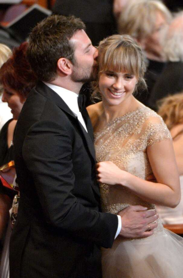 Bradley Cooper, left, kisses Suki Waterhouse in the audience at the Oscars at the Dolby Theatre on Sunday, March 2, 2014, in Los Angeles. Photo: John Shearer, Associated Press
