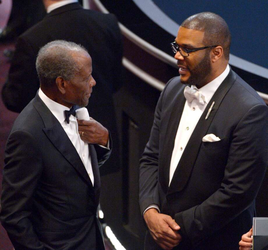 Sidney Poitier, left, and Tyler Perry appear in the audience at the Oscars at the Dolby Theatre on Sunday, March 2, 2014, in Los Angeles. Photo: John Shearer, Associated Press