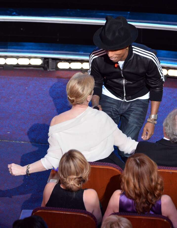 Singer Pharrell Williams performs onstage with Meryl Streep in the audience during the Oscars at the Dolby Theatre on March 2, 2014 in Hollywood, California. Photo: Kevin Winter, Getty Images