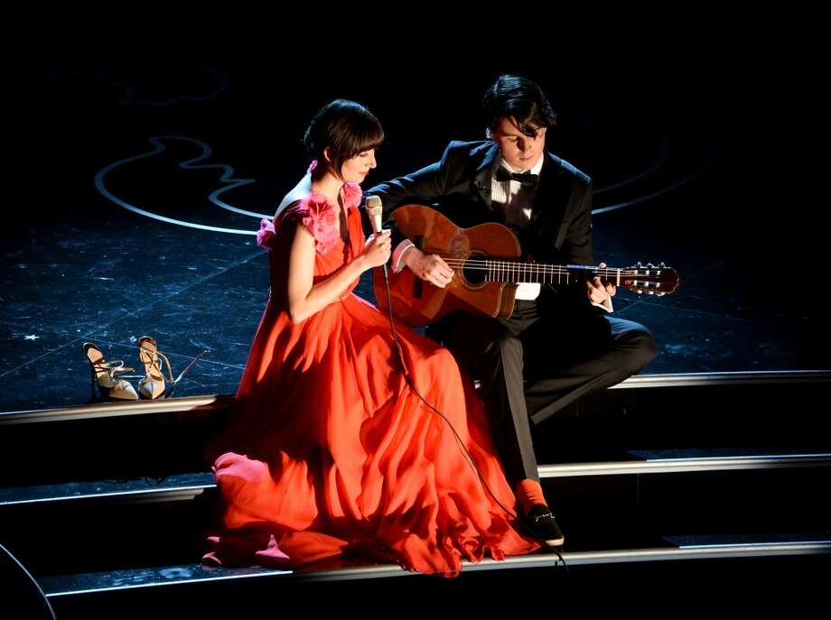 Singer Karen O and musician Ezra Koenig perform onstage during the Oscars at the Dolby Theatre on March 2, 2014 in Hollywood, California. Photo: Kevin Winter, Getty Images