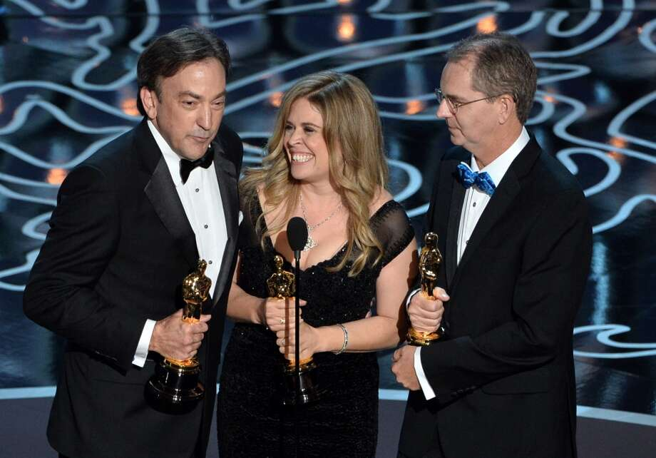 (L-R) Producer Peter Del Vecho, directors Jennifer Lee and Chris Buck accept the Best Animated Feature Film award for 'Frozen' onstage during the Oscars at the Dolby Theatre on March 2, 2014 in Hollywood, California. Photo: Kevin Winter, Getty Images