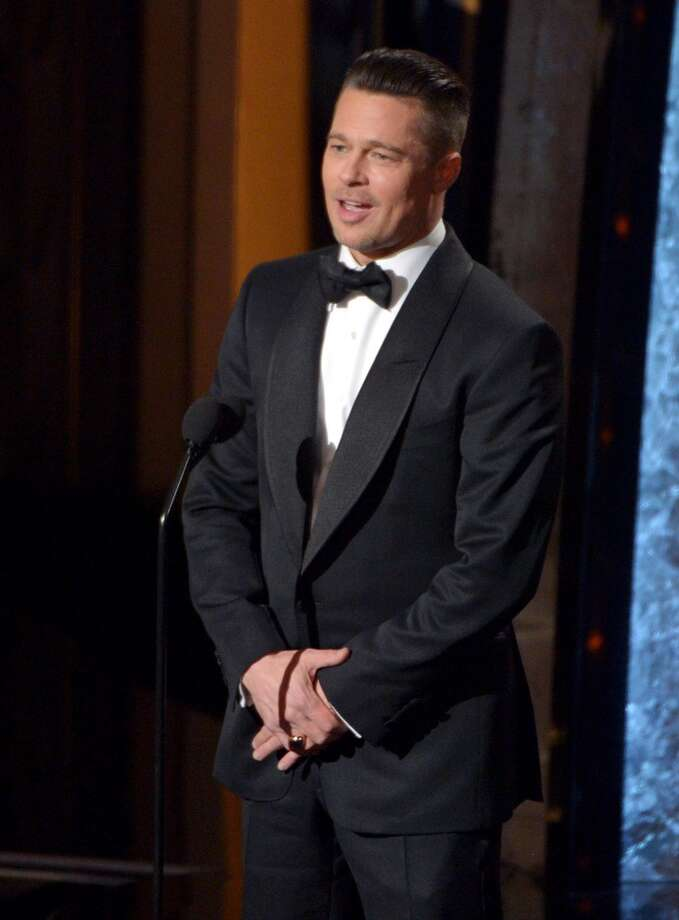 Presenter Brad Pitt speaks during the Oscars at the Dolby Theatre on Sunday, March 2, 2014, in Los Angeles. Photo: John Shearer, Associated Press