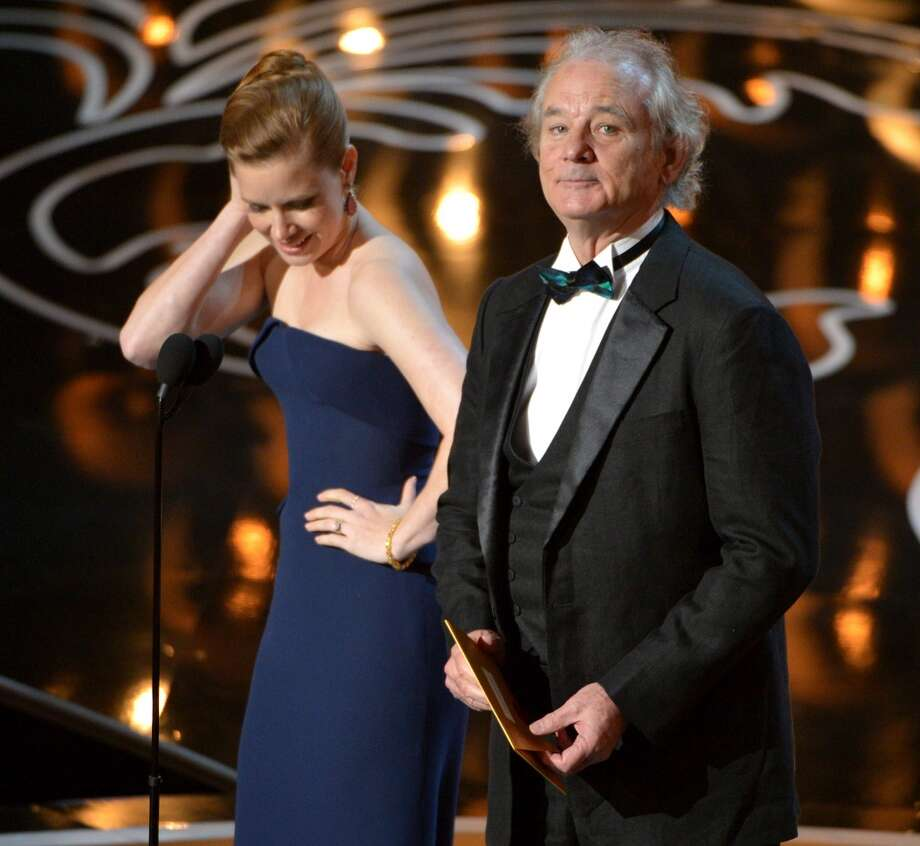 Amy Adams, left, and Bill Murray speak on stage during the Oscars at the Dolby Theatre on Sunday, March 2, 2014, in Los Angeles. Photo: John Shearer, Associated Press