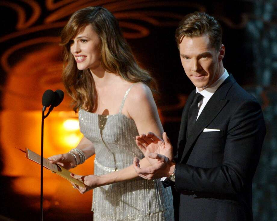 Jennifer Garner, left, and Benedict Cumberbatch speak during the Oscars at the Dolby Theatre on Sunday, March 2, 2014, in Los Angeles. Photo: John Shearer, Associated Press