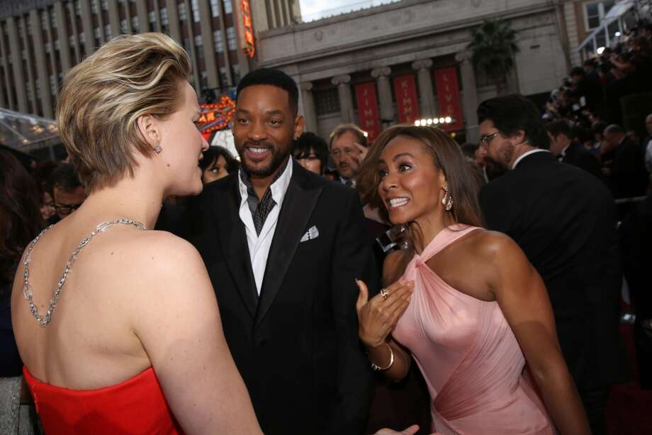Jennifer Lawrence, from left, Will Smith and Jada Pinkett Smith arrive at the Oscars on Sunday, March 2, 2014, at the Dolby Theatre in Los Angeles. Photo: Matt Sayles, Associated Press