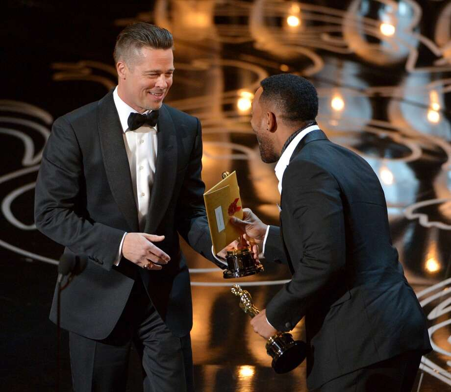 "Will Smith, right, presents Brad Pitt with the award for the best picture for ""12 Years a Slave"" during the Oscars at the Dolby Theatre on Sunday, March 2, 2014, in Los Angeles. Photo: John Shearer, Associated Press"