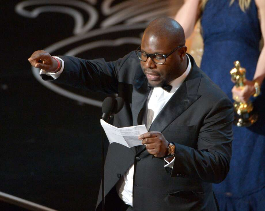 "Steve McQueen accepts the award for the best picture of the year for ""12 Years a Slave"" during the Oscars at the Dolby Theatre on Sunday, March 2, 2014, in Los Angeles. Photo: John Shearer, Associated Press"