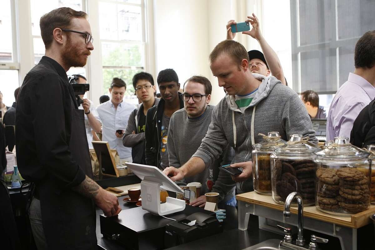 A line of customers at a Blue Bottle coffee in San Francisco.