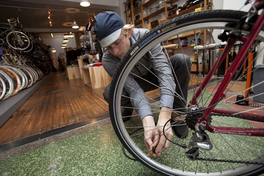 Bikes, bikes and more bikes. First come the bicycle shops and bike racks ... Photo: Stephen Lam, Special To The Chronicle