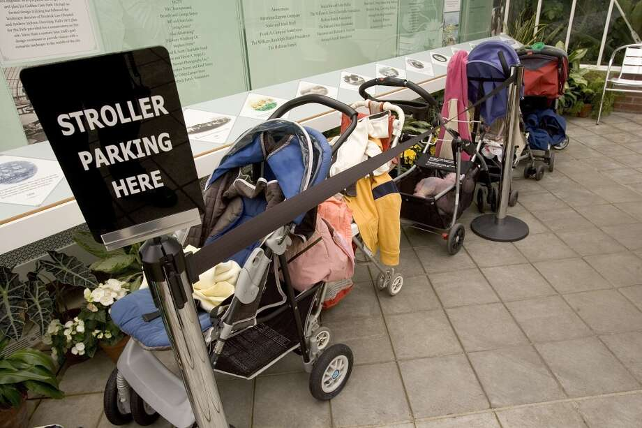 Baby strollers. Lots of expensive  strollers. Also, strollers aren't just exclusive to babies … Photo: David Paul Morris, San Francisco Chronicle