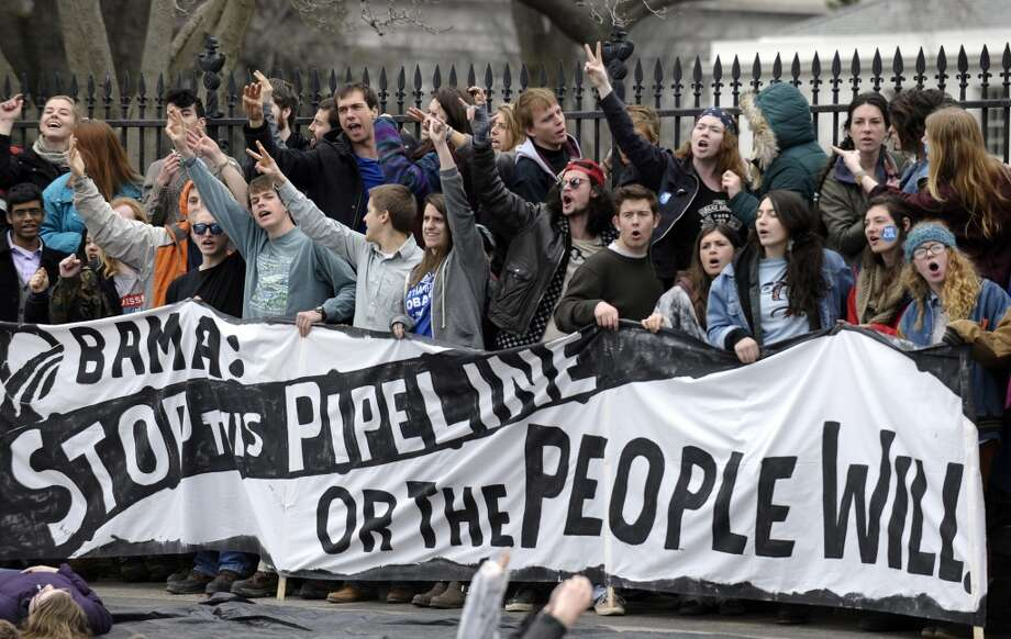 People protest against the XL Pipeline outside the White House in Washington, Sunday, March 2, 2014. (AP Photo/Susan Walsh) Photo: Susan Walsh, ASSOCIATED PRESS