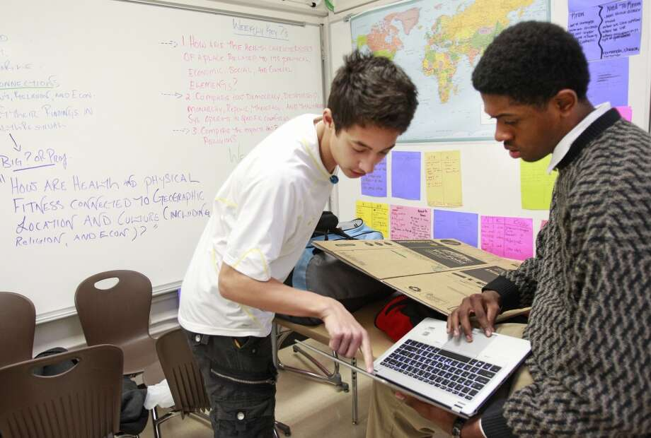 Freshmen students Caio Carugati (left) and David Miller (right), both 15, work on a project about Kuwait at the Energy Institute High School in Houston. It is the first high school in the nation to focus on careers in oil, gas and other energy sources and technologies. Photo: Melissa Phillip, Houston Chronicle