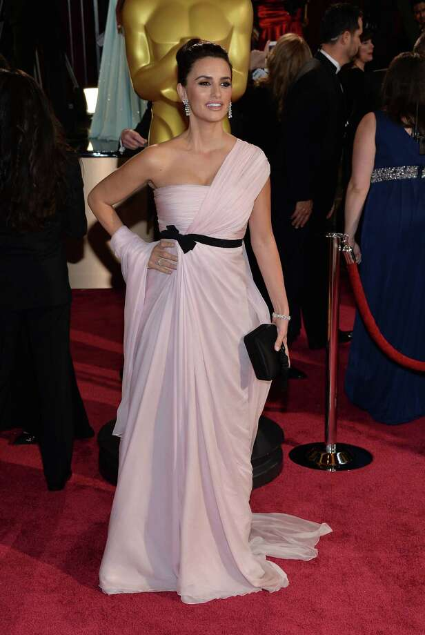 Worst: Penelope Cruz Not a good thing when you have to carry around part of your dress. The dress should be working for you. Photo: Michael Buckner, Getty Images / 2014 Getty Images