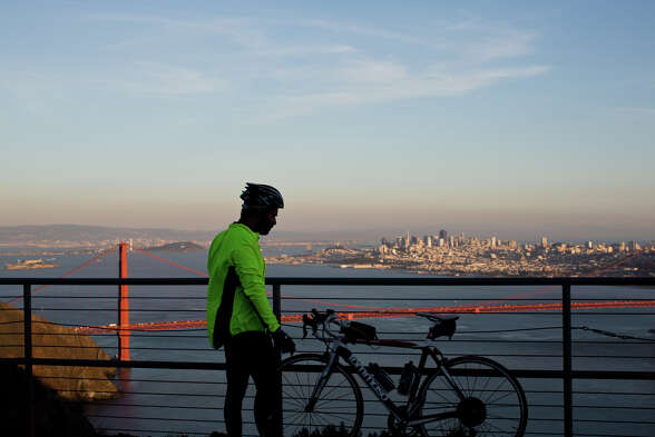 Adil Ansari takes a break after climbing Conzelman Road to Hawk Hill in the Marin Headlands.