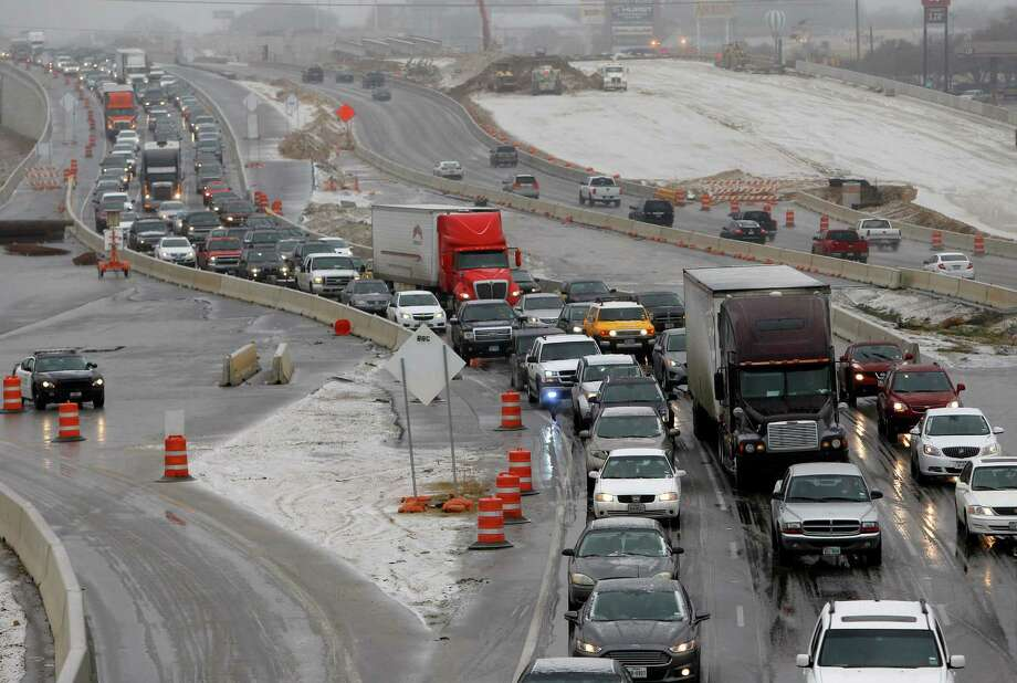 Traffic backs up on Texas 121 in Hurst, Texas, Sunday, March 2, 2014. The National Weather Service issued a winter storm warning for North Texas on Sunday as day-time temperatures dip into the 30s. Forecasts call for freezing rain and sleet that could make driving hazardous. (AP Photo/The Fort Worth Star-Telegram, Richard W. Rodriguez)  MAGS OUT; (FORT WORTH WEEKLY, 360 WEST); INTERNET OUT Photo: Richard W. Rodriguez, Associated Press / The Fort Worth Star-Telegram