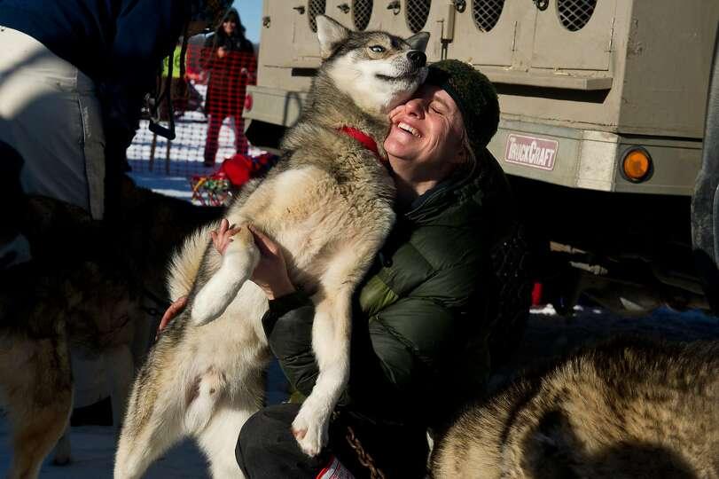 Sue Ellis, wife of musher Mike Ellis, hugs Frankie before the Iditarod Trail Sled Dog Race began on