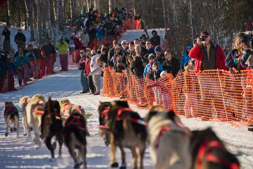 Fans line up along the course for the start of the Iditarod Trail Sled Dog Race on Willow Lake, Sund