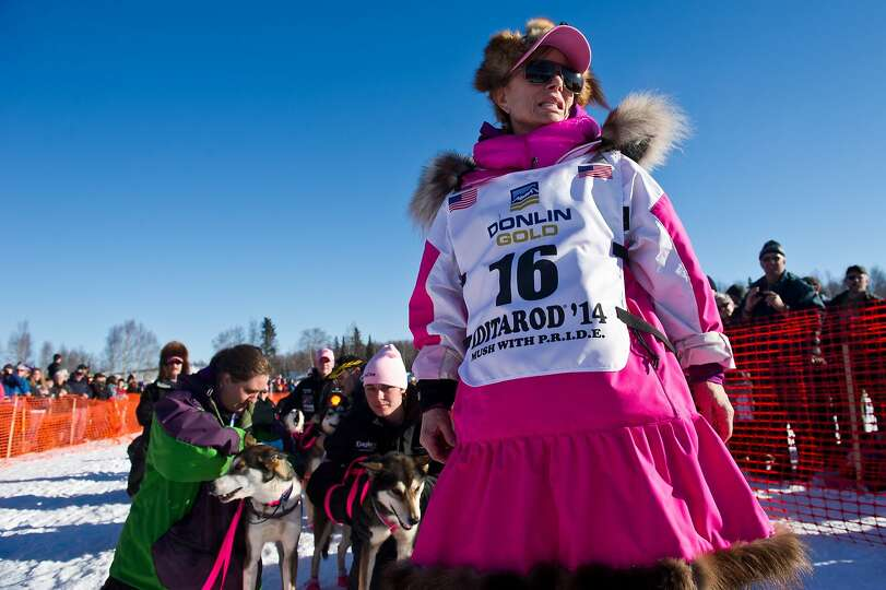 Veteran musher DeeDee Jonrowe leads her team to the starting line for the Iditarod Trail Sled Dog Ra