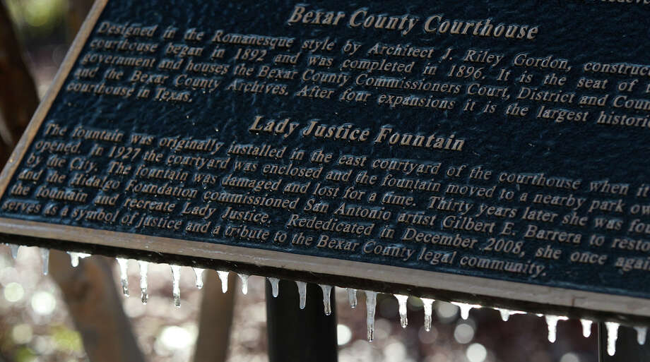 Icicles hang from a plaque in front of the Bexar County Courthouse on Monday March 3, 2013, after a cold front swept through the area. Photo: JOHN DAVENPORT, SAN ANTONIO EXPRESS-NEWS / ©San Antonio Express-News/Photo may be sold to the public
