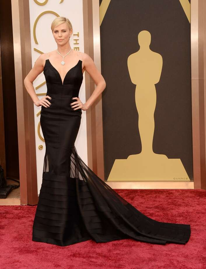 Best: Charlize TheronWe've never seen clear shoulder straps be this elegant before.  Photo: Jason Merritt, Getty Images