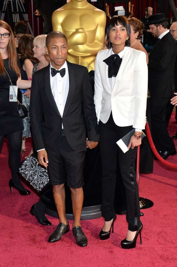 Boldest Statement:  Pharrell Williams (L) and Helen Lasichanh attend the Oscars in coordinated tuxes, his by Lanvin. Photo: Michael Buckner, Getty Images