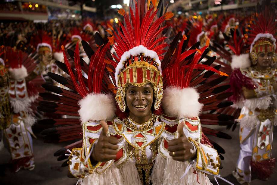 "Members of Beija Flor Samba School perform during their parade at 2014 Brazilian Carnival at Sapucai Sambadrome on March 02, 2014 in Rio de Janeiro, Brazil. Rio's two nights of Carnival parades began today in a burst of fireworks to the cheers of thousands of tourists and locals who have previously enjoyed street celebrations (known as ""blocos de rua"") all around the city. Photo: Buda Mendes, Getty Images"