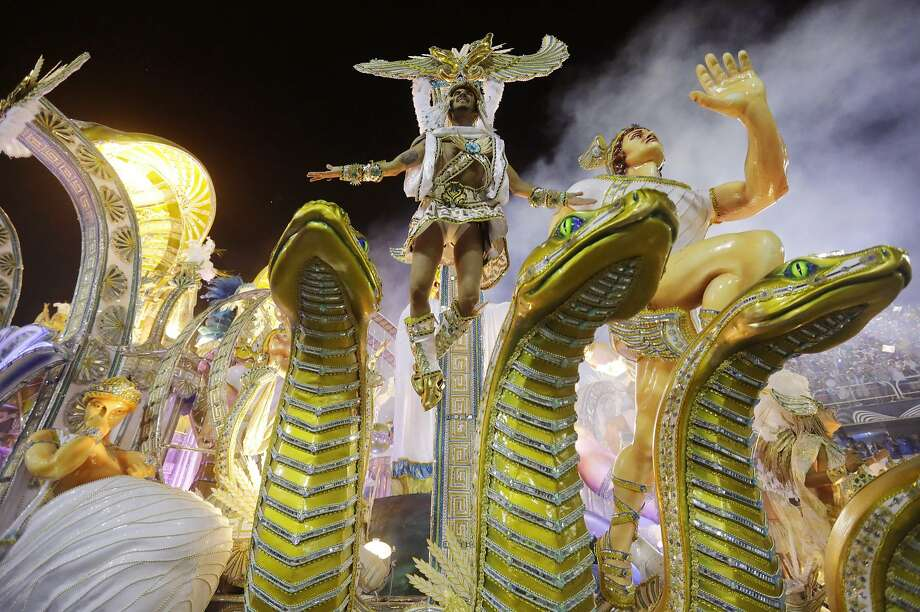 Performers from the Beija Flor samba school parade during carnival celebrations at the Sambadrome in Rio de Janeiro, Brazil, Monday, March 3, 2014. (AP Photo/Nelson Antoine) Photo: Nelson Antoine, Associated Press