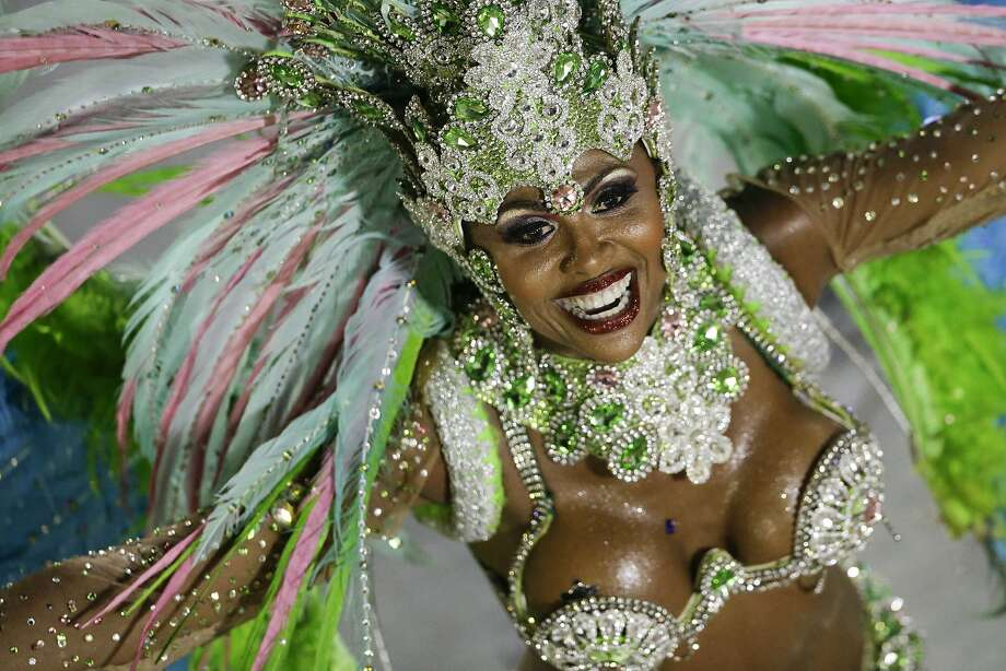 A performer from the Mangueira samba school parades during carnival celebrations at the Sambadrome in Rio de Janeiro, Brazil, Monday, March 3, 2014.  Photo: Felipe Dana, Associated Press