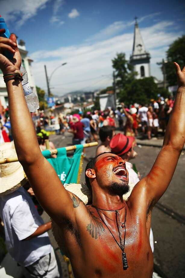 A reveler exalts during the 'Ceu na Terra' street carnival bloco on March 1, 2014 in Rio de Janeiro, Brazil. Carnival is the grandest holiday in Brazil, annually drawing millions in raucous celebrations.  Photo: Mario Tama, Getty Images