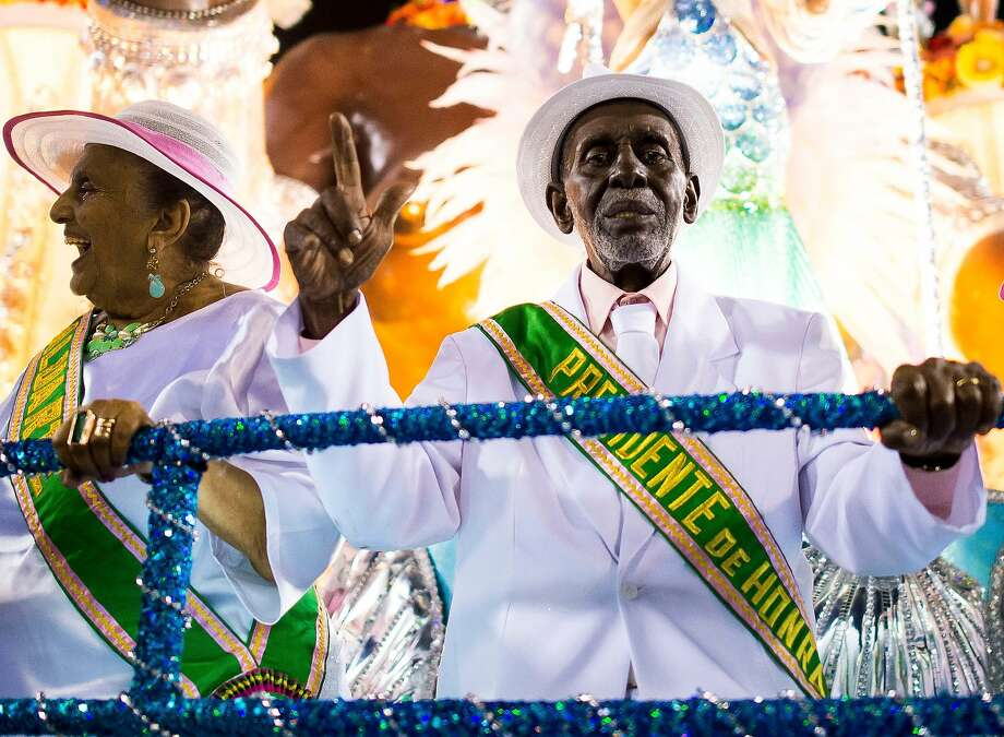 "Nelson Sargento (R) of Mangueira Samba School celebrate during their parade at 2014 Brazilian Carnival at Sapucai Sambadrome on March 02, 2014 in Rio de Janeiro, Brazil. Rio's two nights of Carnival parades begin on March 2 in a burst of fireworks and to the cheers of thousands of tourists and locals who have previously enjoyed street celebrations (known as ""blocos de rua"") all around the city. Photo: Buda Mendes, Getty Images"