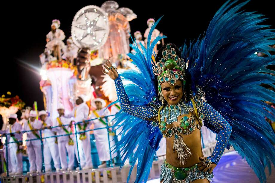 "Members of Mangueira Samba School celebrate during their parade at 2014 Brazilian Carnival at Sapucai Sambadrome on March 02, 2014 in Rio de Janeiro, Brazil. Rio's two nights of Carnival parades begin on March 2 in a burst of fireworks and to the cheers of thousands of tourists and locals who have previously enjoyed street celebrations (known as ""blocos de rua"") all around the city. Photo: Buda Mendes, Getty Images"