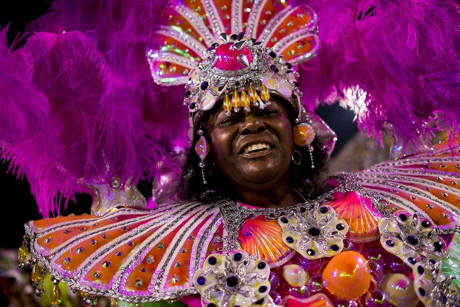"""Members of Mangueira Samba School celebrate during their parade at 2014 Brazilian Carnival at Sapucai Sambadrome on March 02, 2014 in Rio de Janeiro, Brazil. Rio's two nights of Carnival parades begin on March 2 in a burst of fireworks and to the cheers of thousands of tourists and locals who have previously enjoyed street celebrations (known as """"blocos de rua"""") all around the city. Photo: Buda Mendes, Getty Images"""