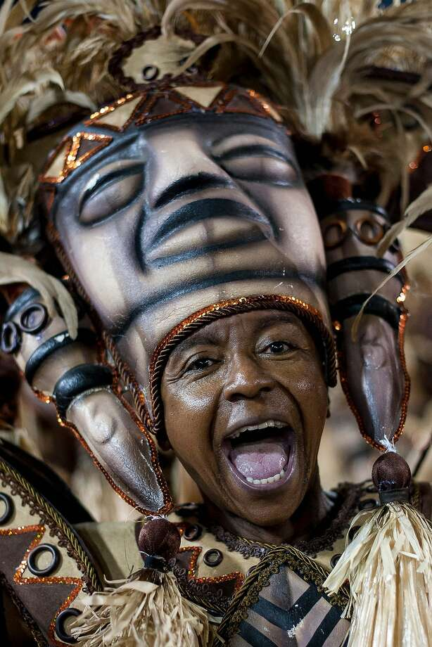 "A member of Salgueiro Samba School performs during their parade at 2014 Brazilian Carnival at Sapucai Sambadrome on March 02, 2014 in Rio de Janeiro, Brazil. Rio's two nights of Carnival parades began today in a burst of fireworks to the cheers of thousands of tourists and locals who have previously enjoyed street celebrations (known as ""blocos de rua"") all around the city. Photo: Buda Mendes, Getty Images"