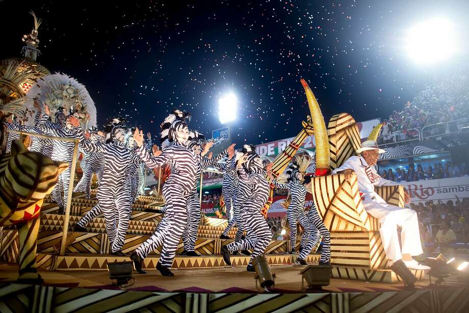 "Members of Salgueiro Samba School perform during their parade at 2014 Brazilian Carnival at Sapucai Sambadrome on March 02, 2014 in Rio de Janeiro, Brazil. Rio's two nights of Carnival parades began today in a burst of fireworks to the cheers of thousands of tourists and locals who have previously enjoyed street celebrations (known as ""blocos de rua"") all around the city.  Photo: Buda Mendes, Getty Images"