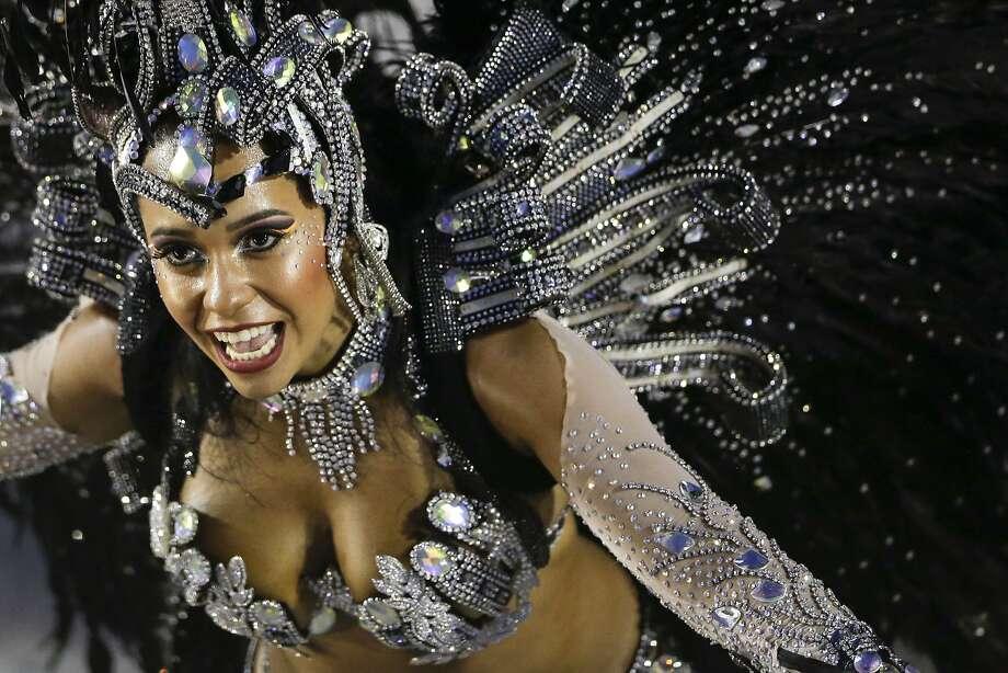 A performer from the Beija Flor samba school parades during carnival celebrations at the Sambadrome in Rio de Janeiro, Brazil, Monday, March 3, 2014. (AP Photo/Felipe Dana) Photo: Felipe Dana, Associated Press