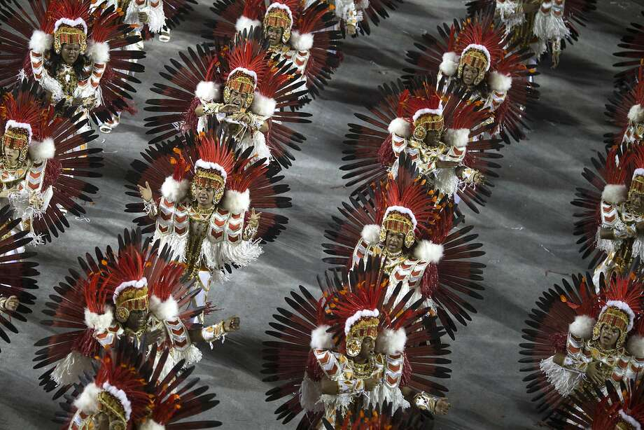 Performers from the Beija Flor samba school parade during carnival celebrations at the Sambadrome in Rio de Janeiro, Brazil, Monday, March 3, 2014. (AP Photo/Felipe Dana) Photo: Felipe Dana, Associated Press