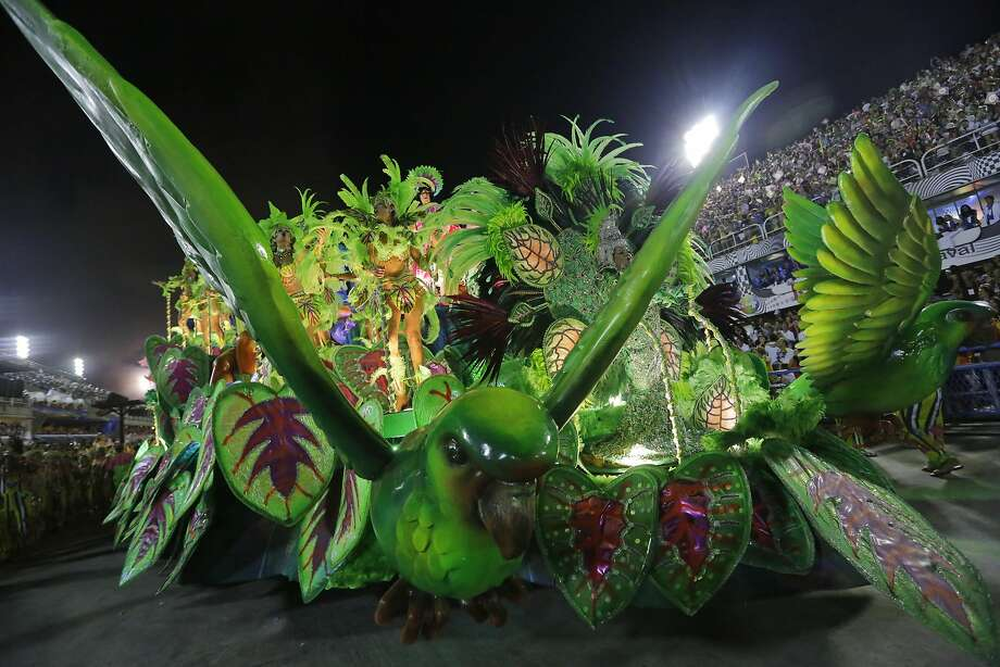 Performers from the Mangueira samba school parade during carnival celebrations at the Sambadrome in Rio de Janeiro, Brazil, Monday, March 3, 2014. (AP Photo/Nelson Antoine) Photo: Nelson Antoine, Associated Press