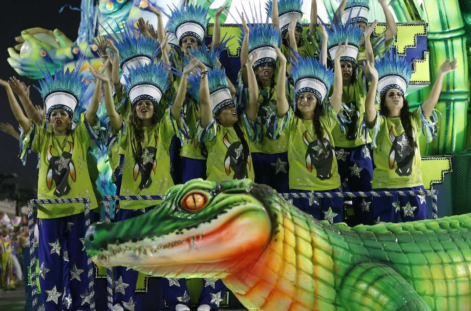 Performers from the Mangueira samba school parade during carnival celebrations at the Sambadrome in Rio de Janeiro, Brazil, Monday, March 3, 2014. (AP Photo/Silvia Izquierdo) Photo: Silvia Izquierdo, Associated Press